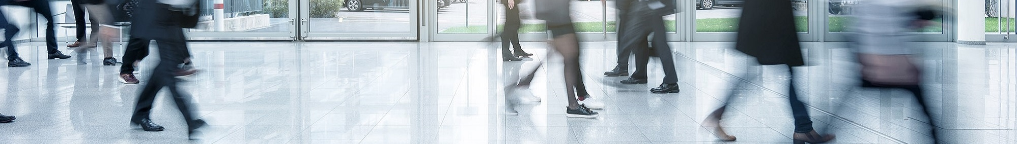 People walking through building foyer