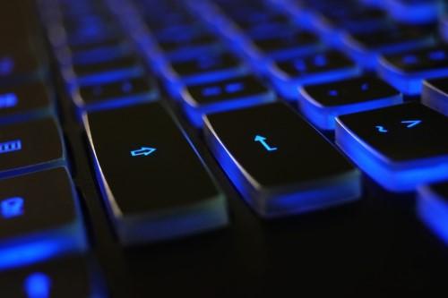 Close-up of blue backlit keyboard
